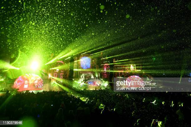 Revelers dance as a DJ performs during the first winter edition of the Tomorrowland electronic music festival in l'Alpe d'Huez eastern France on...