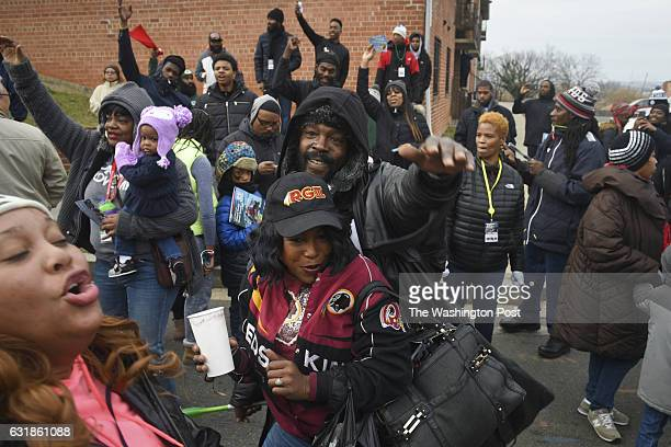 Revelers dance as the 11th Annual MLK Peace Walk and Parade makes its way up Martin Luther King Avenue SE on Monday January 16 in Washington DC