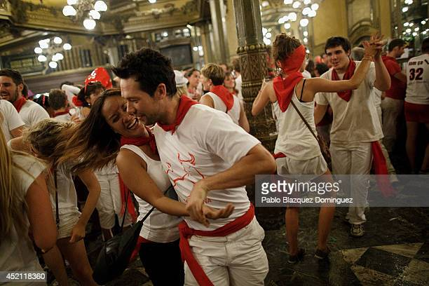 Revelers dance in a bar during the eighth day of the San Fermin Running Of The Bulls festival on July 13 2014 in Pamplona Spain The annual Fiesta de...