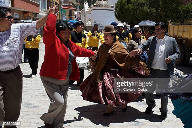 Revelers dance in a parade, during the festival of the Virgen de la Candelari. One of Bolivia's most famous festivals, the festival of the Virgen de...