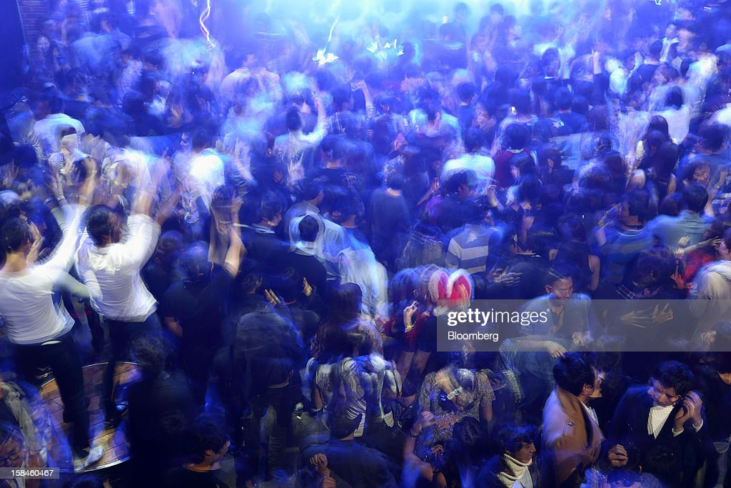 Revelers dance inside Club Ellui in the Gangnam district of Seoul, South Korea, on Sunday, Dec. 16, 2012. South Koreans vote on Dec. 19 to replace President Lee Myung Bak, whose five-year term ends in February. Photographer: SeongJoon Cho/Bloomberg via Getty Images