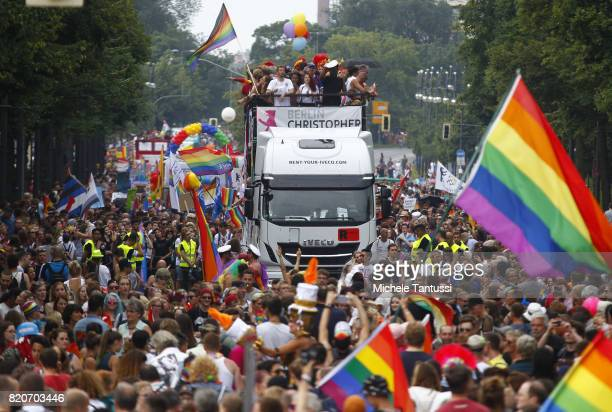 Revelers dance on decorated trucks during the 2017 Christopher Street Day gay pride celebration on July 22 2017 in Berlin Germany The Bundestag...