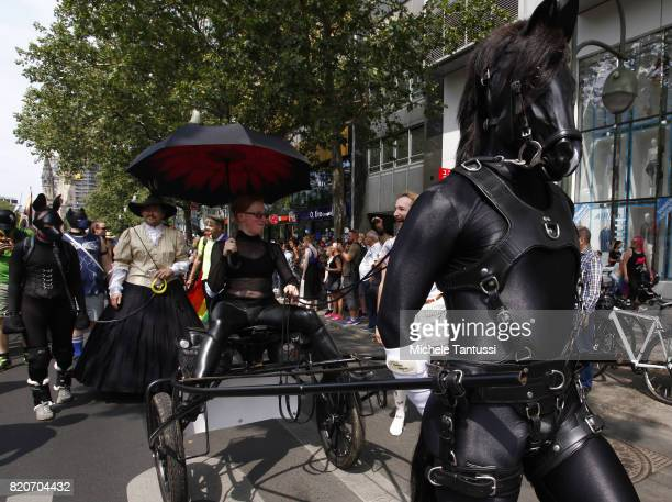 Revelers dance on during the 2017 Christopher Street Day gay pride celebration on July 22 2017 in Berlin Germany The Bundestag Germany's parliament...