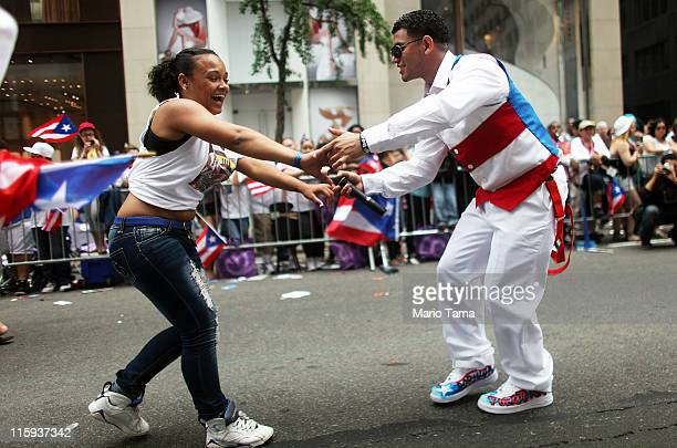 Revelers dance on Fifth Avenue during the Puerto Rican Day Parade on June 12 2011 in New York City The Puerto Rican Day Parade draws hundreds of...