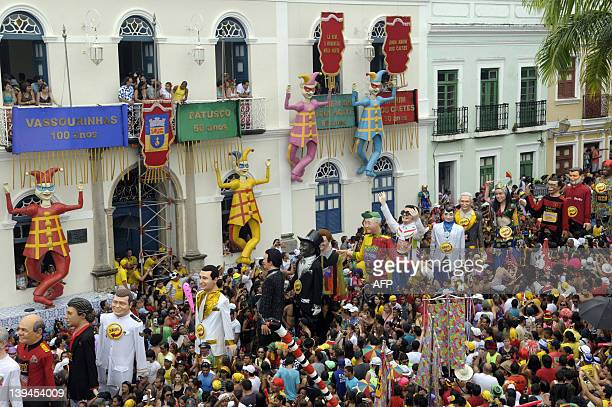 Revelers dance to the sound of Frevo a traditional musical style of Pernambuco state amidst giant dolls during carnival celebrations in Olinda...