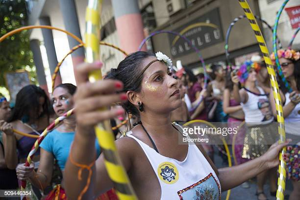 Revelers dance with hula hoops during the Bloco das Mulheres Rodadas Carnival parade in Rio de Janeiro, Brazil, on Wednesday, Feb. 10, 2016. The...