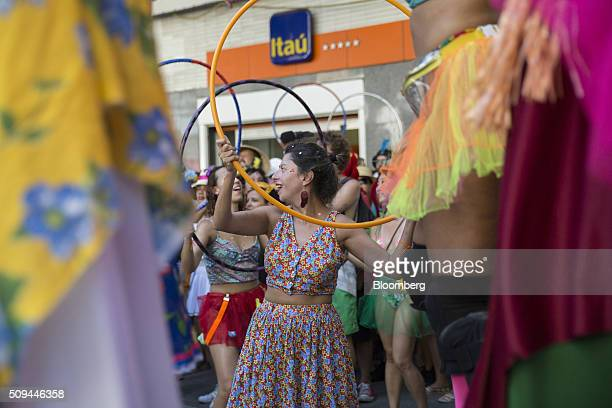 Revelers dance with hula hoops during the Bloco das Mulheres Rodadas Carnival parade in Rio de Janeiro Brazil on Wednesday Feb 10 2016 The Bloco das...