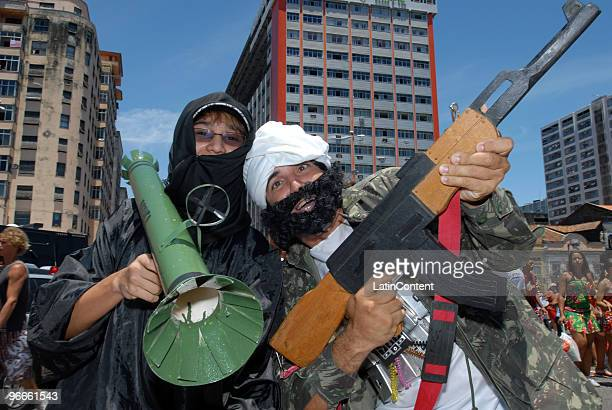 Revelers disguise as terrorists during the Galo da Madrugada the socalled biggest Carnival parade on earth during 2010 carnival celebrations on...