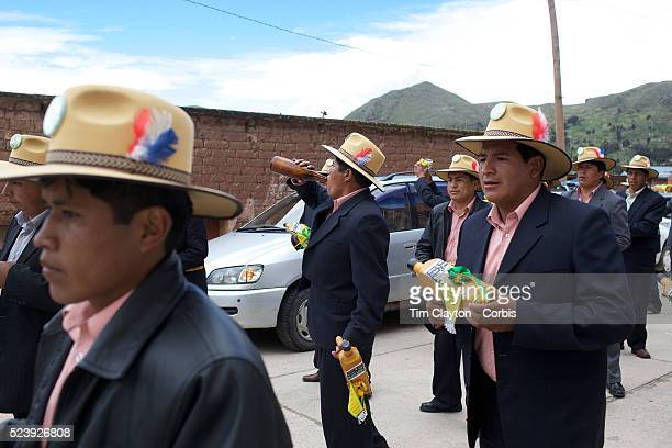 Revelers drink and participate in a parade, during the festival of the Virgen de la Candelari. One of Bolivia's most famous festivals, the festival...