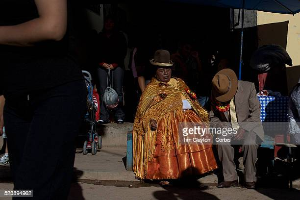 Revelers drink and pass out, during the festival of the Virgen de la Candelari. One of Bolivia's most famous festivals, the festival of the Virgen de...