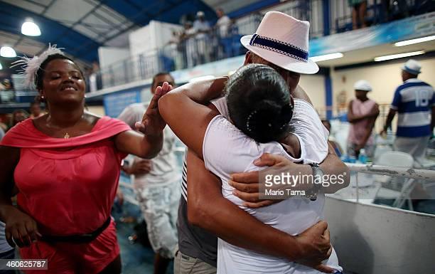 Revelers embrace at a traditional samba and feijoada party held at the Portela Samba School in the Madureira neighborhood during preCarnival...