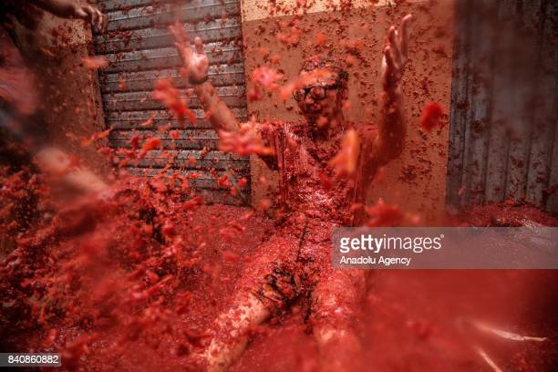 Revelers enjoy during the annual La Tomatina festival in Bunol district of Valencia Spain on August 30 2017