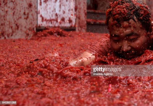 Revelers enjoy in tomato pulp during the annual La Tomatina festival in Bunol district of Valencia Spain on August 30 2017