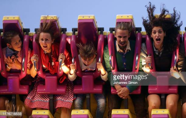 Revelers enjoy riding 'Top Spin' a kind of modern merrygoround during the opening weekend of the 2019 Oktoberfest on September 21 2019 in Munich...