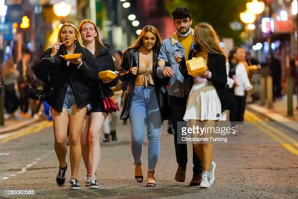 """Revelers enjoy their last night out in the city centre as tomorrow the """"very high"""" risk lockdown regulations come into effect on October 13, 2020 in..."""