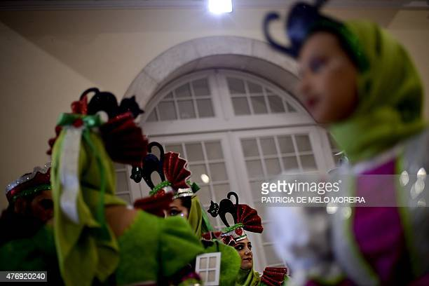 Revelers from one of Lisbon's neighborhoods Alfama gather moments before going to the Saint Anthony's Parade on Avenida da Liberdade in Lisbon on...