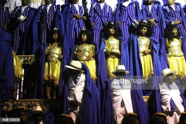 Revelers from the Portela samba school wait on a float as they prepare to perform at the Sambodrome in the early morning hours during Carnival...