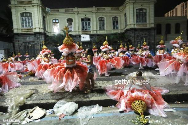 Revelers from the Portela samba school wait to perform outside the Sambodrome in the early morning hours during Carnival festivities on February 28...