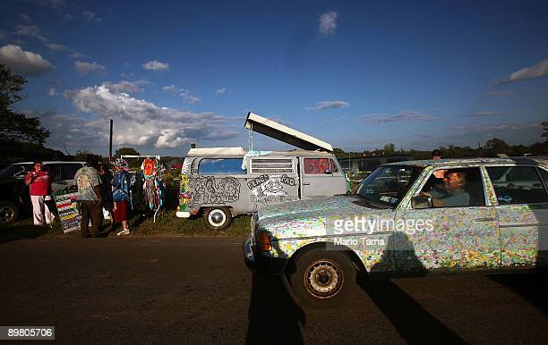 Revelers gather as the 40th anniversary of the Woodstock music festival approaches August 14 2009 in Bethel New York On August 1517 in 1969 an...
