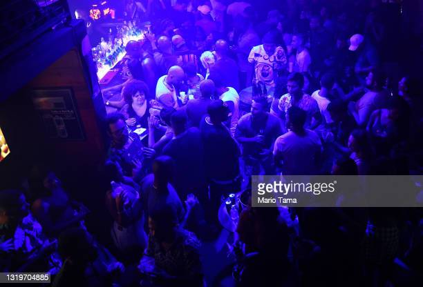 Revelers gather in a nightclub in the early morning hours amid the COVID-19 pandemic on May 23, 2021 in Rio de Janeiro, Brazil. COVID-19 has now...