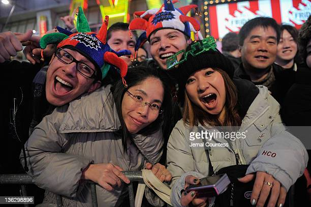 Revelers gather together as thousands gather in New York's Times Square to celebrate the ball drop at the annual New Years Eve celebration on...