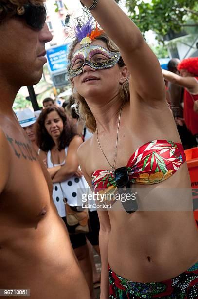 Revelers gather with the traditional Banda the Ipanema band at Ipanema beach during Rio de Janeiro's carnival on February 132010 in Rio de Janeiro...