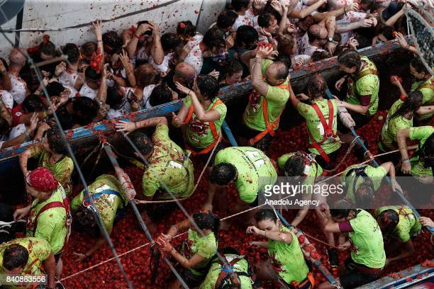 Revelers hurl tomatoes during the annual La Tomatina festival in Bunol district of Valencia Spain on August 30 2017