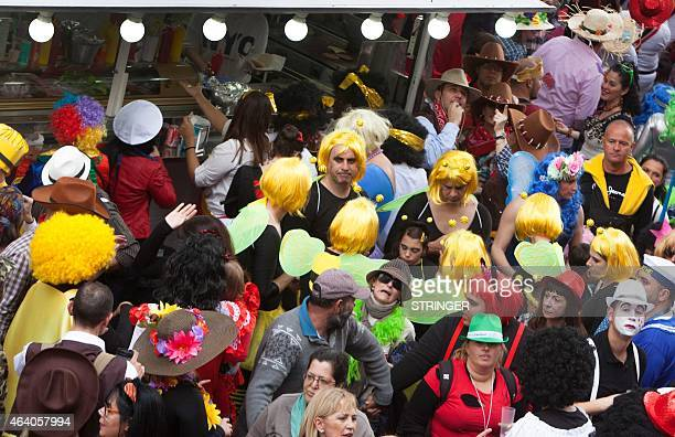Revelers in fancy dress party during the last daytime event of the Santa Cruz de Tenerife carnival themed this year on the future in Santa Cruz de...