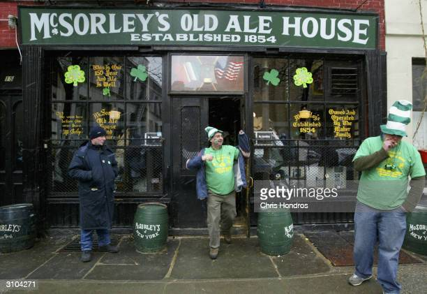 Revelers in green leave historic McSorley's Old Ale House March 17 2004 in New York New Yorkers of many ethnicities but especially its 800000...