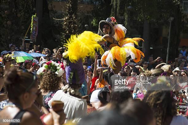 Revelers including a stilt walker center dance in the street during the Bloco das Mulheres Rodadas Carnival parade in Rio de Janeiro Brazil on...