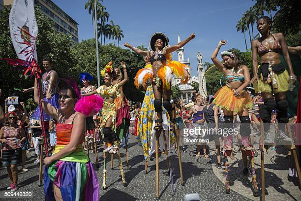 Revelers including stilt walkers dance in the street during the Bloco das Mulheres Rodadas Carnival parade in Rio de Janeiro Brazil on Wednesday Feb...