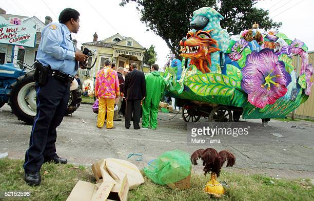 Revelers inspect a brokendown float during the historic Proteus parade founded in 1882 during Mardi Gras festivites February 7 2005 in New Orleans...
