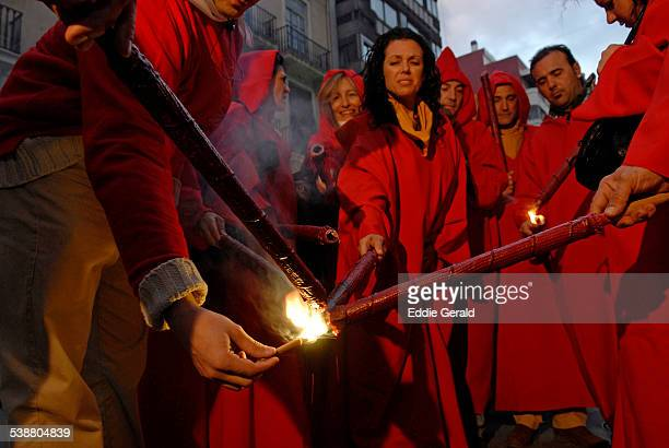 Revelers lighting firecrackers during Las Fallas festival in Valencia Spain