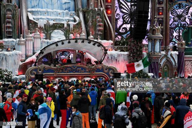 Revelers listen to a DJ performing during the first winter edition of the Tomorrowland electronic music festival in l'Alpe d'Huez eastern France on...