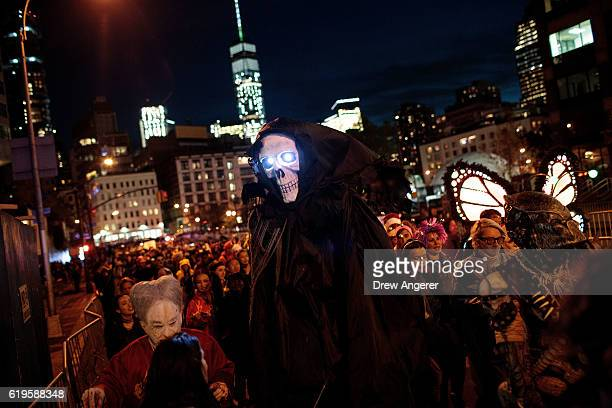 Revelers make their way along Sixth Avenue during the 43rd annual Village Halloween Parade October 31 2016 in New York City Thousands of people are...