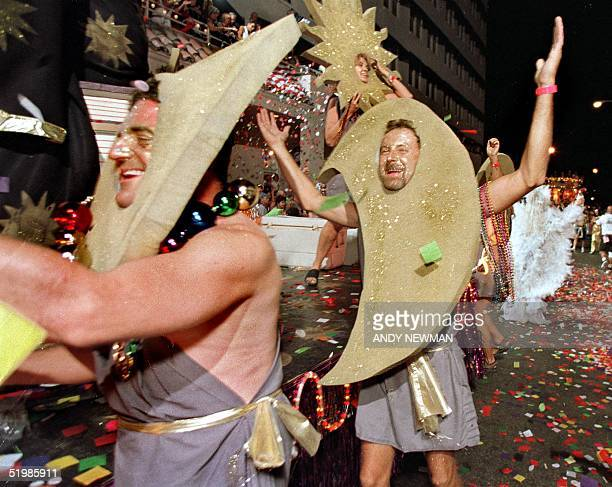 Revelers makes their way down Duval Street in Key West Florida late 27 October 2001 during the Fantasy Fest Parade a highlight event of the annual...