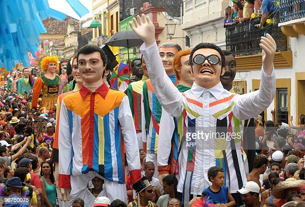 Revelers observe the traditional giant dolls along the streets of Olinda in northeastern Brazil on February 16 2010 The giant dolls street band is a...
