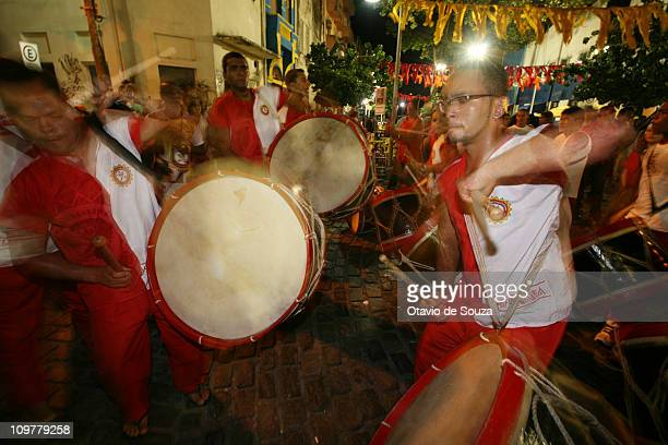 Revelers of Maracatu ensembles perform during the opening of the carnival at the streets of Recife Antigo on March 4 2011 in Recife Brazil