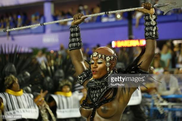 IMAGE CONTAINS NUDITY Revelers of Samba School Imperatriz Leopoldinense perform during the parade at 2019 Brazilian Carnival at Sapucai Sambadrome on...