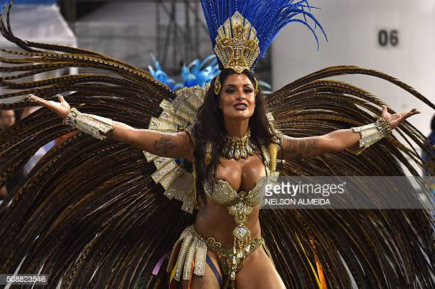 Revelers of the Academicos do Tucuruvi samba school perform during the second night of the carnival parade at the Sambadrome in Sao Paulo Brazil on...