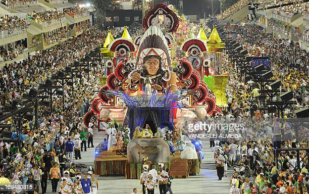 Revelers of the Estacao Primeira de Mangueira samba school perform atop a float during the second night of Carnival parades at the Sambadrome in Rio...
