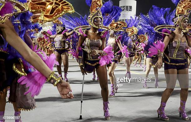 Revelers of the Nene de Vila Matilde samba school perform during the second night of carnival parade at the Sambadrome in Sao Paulo Brazil on March...