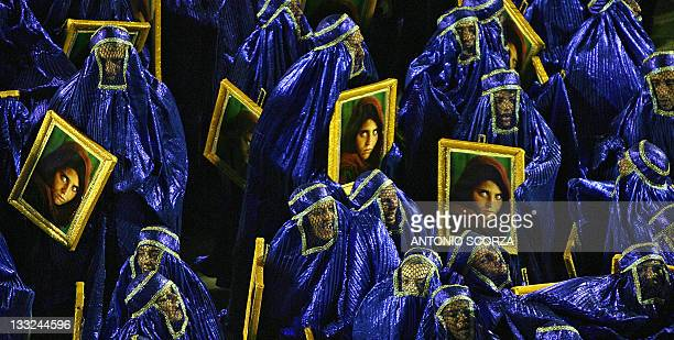 Revelers of the 'Unidos da Tijuca' samba school fancy dressed with burkas perform at the Sambadrome during the second night of carnival celebrations...