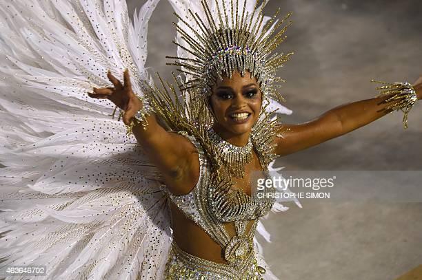Revelers of the Unidos da Tijuca samba school perform during the second day of carnival parade in the Sambodrome in Rio de Janeiro Brazil on February...
