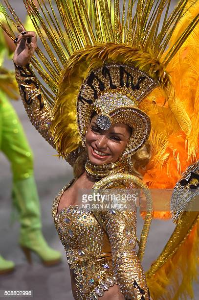 Revelers of the Unidos do Peruche samba school perform during the second night of the carnival parade at the Sambadrome in Sao Paulo Brazil on...