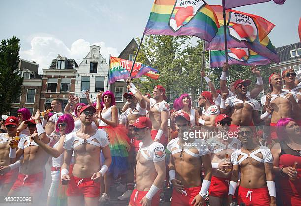 Revelers on a boat parading the Prinsengracht canal participating in the Amsterdam Canal Parade during Amsterdam Gay Pride on August 2 2014 in...