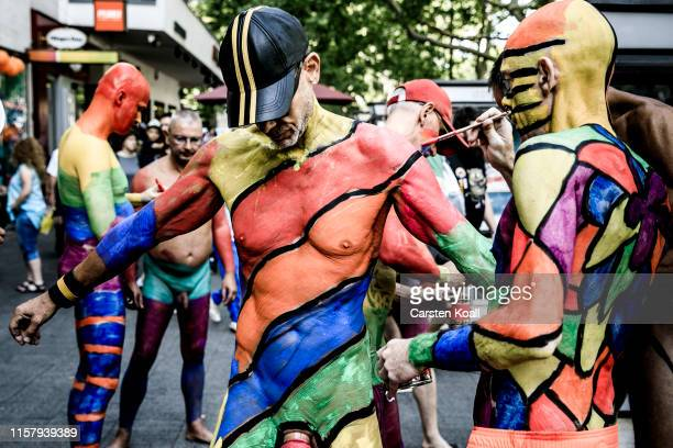 Revelers paint each other before they take part in the annual Christopher Street Day parade on July 27 2019 in Berlin Germany This year's CSD is...