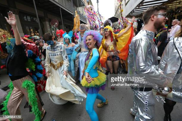 Revelers parade in the French Quarter during Fat Tuesday celebrations on February 25 2020 in New Orleans Louisiana Fat Tuesday or Mardi Gras in...