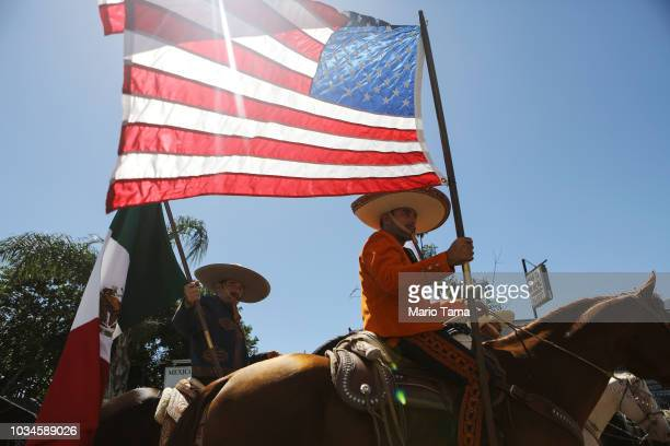 Revelers parade on horseback with American and Mexican flags during the 72nd annual East LA Mexican Independence Day Parade on September 16 2018 in...
