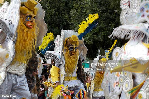 Revelers participate in a parade, during the festival of the Virgen de la Candelari. One of Bolivia's most famous festivals, the festival of the...